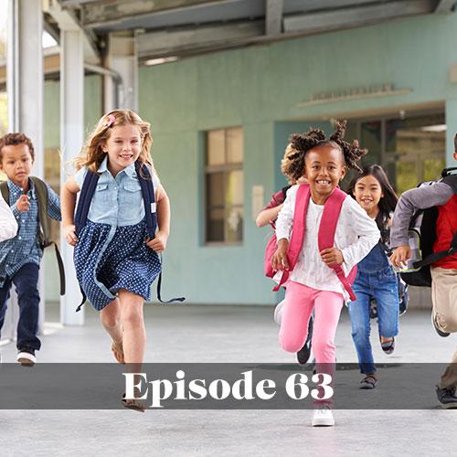 Children running through public school hallway