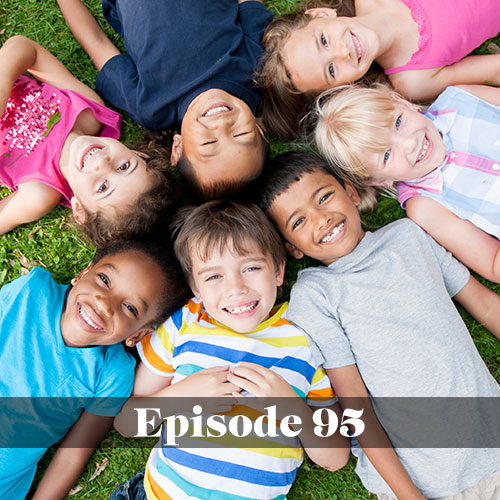 Pre-kindergarten in public schools, group of pre-K students laying in the grass and smiling